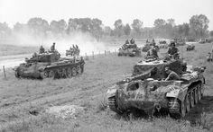 British Cromwell tanks assembled for Operation Goodwood, the attempted breakout from the D Day beachhead in July 1944.  The operation was a tactical failure but a strategic success: the Germans used the bulk of their Armour in Normandy to contain it, leaving little to oppose the US Operation Cobra, which broke out a few days later.