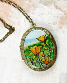 California Poppies -- Hand Painted Brass Recessed Ornate Locket by Sarah-Lambert Cook  http://www.sarahlambertcook.com/collections/lockets/products/california-poppies-hand-painted-brass-recessed-ornate-locket