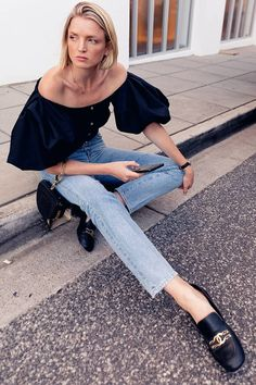 nyc summer outfits off-the-shoulder top jeans loafers