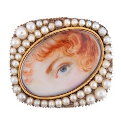 A gold, silver and pearl lover's-eye brooch, 1820. (1stdibs.com)