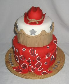 Red bandana and cowboy hat cupcake - This is a fondant extravaganza -- the hat, the covered tiers, the fringe, the stars - all fondant. Paisley was piped with royal icing. 6 and 8 inch rounds. Cowgirl Cakes, Western Cakes, Cowboy Birthday Party, Birthday Cake, Cowboy Party, Birthday Ideas, 5th Birthday, Birthday Parties, Fantasy Cake