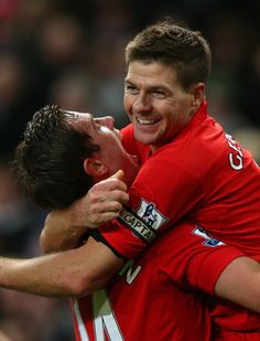 Steven Gerrard and Jordan Henderson celebrating
