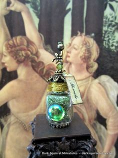 Deluxe Green Fairy Absinthe Potion Bottle ooak dollhouse miniature in one inch scale. $12.00, via Etsy.