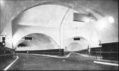 THE MERSEY TUNNEL - THE JUNCTION CHAMBER on the Birkenhead side of the tunnel. The branch tunnel leads to the dock system, and the roadway is 19 feet wide between kerbs. The chamber was excavated to a height of 48 feet for a length of 55 feet and a width of 72 feet. A black glass dado, 6 ft. 3 in. high, lines the tunnel. Fire-alarm stations and telephone boxes are arranged at intervals of 150 feet and ordinary traffic signals control the traffic at the junctions.