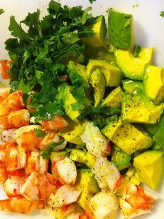 Shrimp salad in the making. Seasoned boiled shrimp, avocado, cilantro and a tart citrus vinegarette.