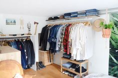 Jimmy and Damien work for locally-rooted Levi's and Old Navy, respectively, so their makeshift closet is organized perfectly and full of inspiration.
