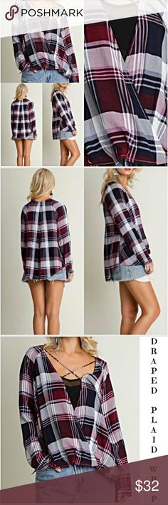 "Draped Plaid Criss Cross Surplice Top Small Add some flare to your plaid in this gorgeous draped front hi low criss-cross  wrap-top in plum.  Should be worn with a cami or tank underneath as this is an open front wrap style. Loving the draped front to cover tummy issues Super cute with any denim jeans or shorts & leggings. Transitions nicely from season to season. Small 2/4/6  Med 6/8/10  65% cotton 35% Polyester  Measurements taken from a small Bust 42"" Front Length 24"" Back 27"" Tops"
