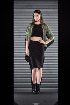 Black two piece crop top and pencil skirt set paired with a green jacket and military boots from CASTRO's #flavorsoffall fashion show