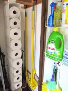 broom closet organization; use a shoe organizer to hold paper towels. (Use this in hall closet.)