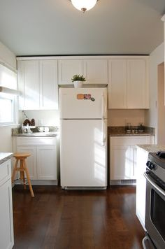Ceiling color: Quiet Moments by Benjamin Moore Kitchen cabinets: Swiss Coffee by Behr