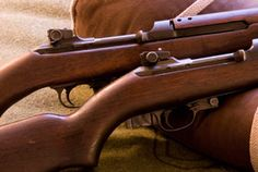 The M1 Carbine was designed primarily to offer noncombat and line-of-communications troops a better defensive weapon than a pistol or submachine gun, with greater accuracy and range, but without the recoil, cost, or weight of a full-power infantry rifle.