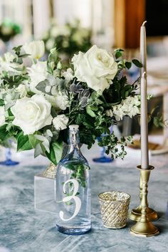 Wedding table decorated by plates, bottle number Stock Photos , Pin Collection, Wedding Table, Glass Vase, Plates, Candles, Stock Photos, Style Inspiration, Table Decorations, Bridal