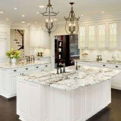 White Granite Countertops on White cabinets with dark floor