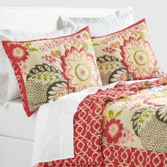 Featuring a modern floral motif from India and bold red geometric design along the border and the reverse, our exclusive cotton quilt punches up the style of any bedroom. Completely double-sided, it pairs with our coordinating pillow shams to achieve a cozy layered look.