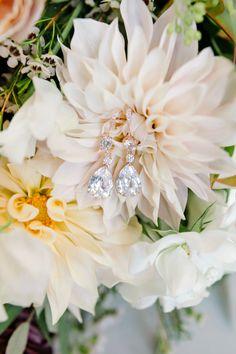 Three diamond wedding earrings: http://www.stylemepretty.com/texas-weddings/buda-texas/2016/12/19/rustic-elegant-texas-wedding-full-of-love/ Photography: Julie Wilhite - http://juliewilhite.com/