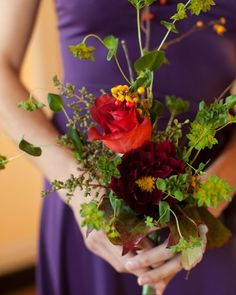 Each bridesmaid carried a bouquet of 'Leonidas' roses, bittersweet, and dahlias, with herb accents.