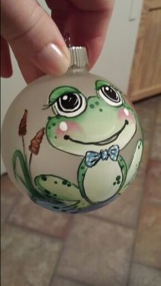 Frog Ornament-someone who can draw and paint needs to make me this Frog Ornaments, Painted Christmas Ornaments, Hand Painted Ornaments, Handmade Ornaments, Christmas Baubles, Christmas Art, Christmas Projects, Holiday Crafts, Christmas Decorations