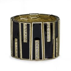 Featuring the classic combination of jet black and shiny gold, the Evelyn Cuff is augmented with bands of rhinestones. Pair Evelyn with a crisp white shirt and black pants and get your mod on! #bracelet