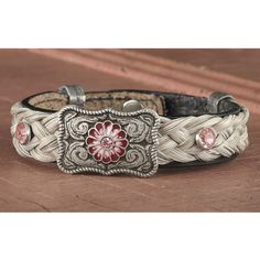 Handcrafted bracelet is made from genuine leather and beautifully braided horsehair, accented with a silvertone concho and pink crystals. Snap closure.