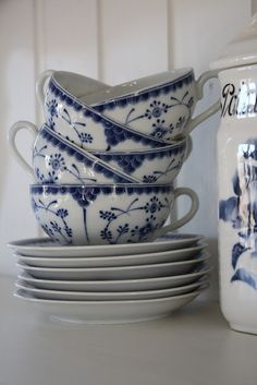 Blue and White Teacups and Saucers