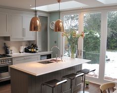 again with pale blue walls and white cabinetry