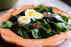 Pioneer Woman's   Spinach Salad with Warm Bacon Dressing    3 whole Eggs  7 slices Thick Cut, Peppered Bacon  1 whole Red Onion, Small  1 package Mushrooms, White Button  8 ounces, weight Baby Spinach, Washed Dried And Stems Removed  3 Tablespoons Reserved Bacon Grease  3 Tablespoons Red Wine Vinegar  2 teaspoons Sugar  1/2 teaspoon Dijon Mustard  1 dash Salt