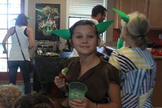 Yoda Ears - a must for a Star Wars party!  Head bands (4/$1 at the dollar store) and a few sheets of green foam paper.  Cut foam paper into quarters, 2 ears per quarter.  Cut 2 slits in each ear so that the ears will curl slightly as you slide them onto the headband.  So simple and dirt cheap!  Everybody loved them!