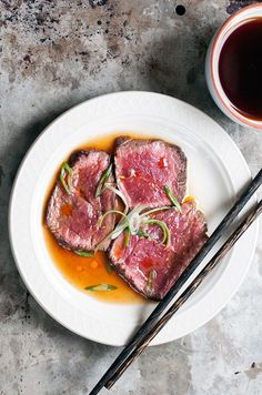 A popular Japanese dish, tataki refers to beef or fish that is quickly seared over high heat, leaving the center very rare. It's thinly sliced and served with a citrus- and ginger-infused vinegar soy sauce.