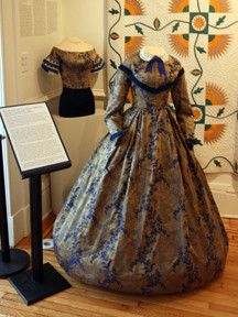 UFAM's magnificent blue and   gold silk 1850s-1860s dress is on display.  Civil War Gallery - Virginia Quilt Museum