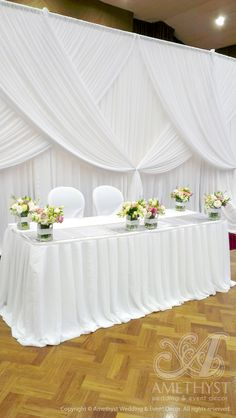 Pleated chiffon bridal table skirting with gorgeous wedding backdrop (criss-crossed drapings)