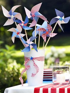 Fourth of July Pinwheels -- How-to instructions for creating a DIY scrapbook-paper pinwheel. #fourthofjuly
