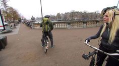 S26E9: Biking along the Amstel River. Amsterdam