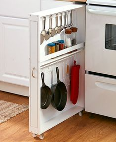 """Make the most of the unused space in your kitchen with this Slim Rolling Kitchen Organizer. At 3-1/2""""W, it's narrow enough to be placed between your cabinet and"""