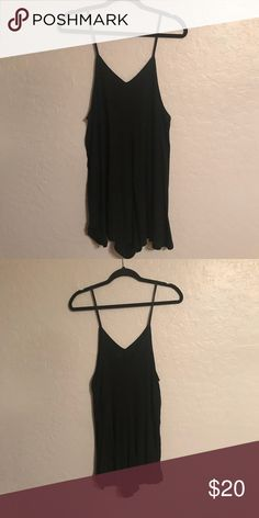 Free People heathered Black Spaghetti Strap Romper Free People heathered black spaghetti strap romper. Flowy and cute! 65% Polyester 35% Rayon Free People Pants Jumpsuits & Rompers