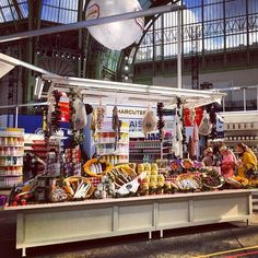 Chanel goes to market... the super market. Check out Karl Lagerfeld's latest produced-focused runway vision, staged at the Grand Palais in Paris.