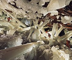 The Cave of the Crystals, Naica, Mexico It looks like Superman's Fortress of Solitude come to life. A thousand feet underground in a working lead and silver mine in Chihuahua, Mexico, opaque crystals of gypsum—some as large as four feet wide and 50 feet long—sprout at all angles from the volcanically heated water below. Temperatures in the cave, which was discovered only in 2000, can reach 150 degrees with nearly 100 percent humidity, conditions that only a superhuman could survive in for…