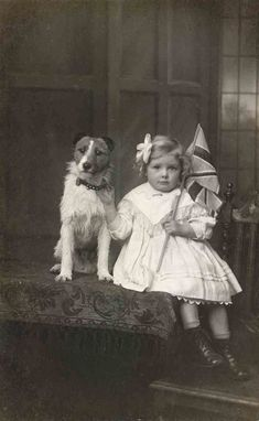 Girl with Union Jack and her dog.