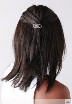 Fun short hair featuring the ever popular Celtic knot flexi clip comfortably securing a half up style.