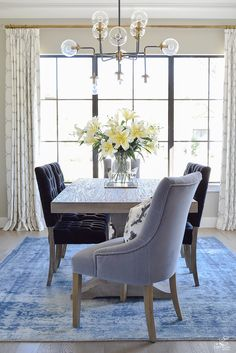tip to make your home feel cozy and inviting with curtains, flowers and art blue vintage inspired rug black tufted dining chairs kravet riad custom curtains sw mindful gray-1