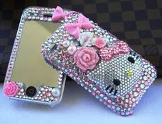 deco den hello kitty bling phone from http://www.pinkz80.com/2010/02/my-new-found-love-for-deco-den.html