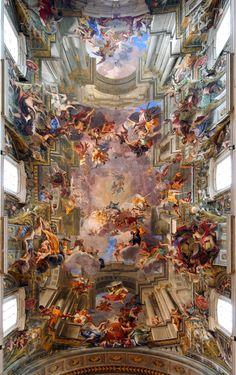 """Andrea Pozzo, Apoteosi di Sant'Ignazio, 1685 Si tratta del massimo capolavoro del pittore gesuita, che qui sfruttò tutta la sua sapienza prospettica, realizzando un tipico """"sfondato"""" barocco, che idealmente prosegue le strutture architettoniche della chiesa innalzandola fino al cielo dove viene ambientata la raffigurazione."""