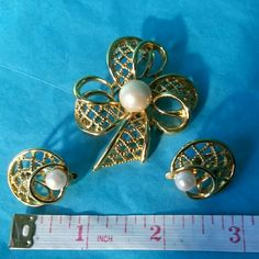 Vintage TRIFARI TM Pin & Clip- on Earrings In excellent shape. Goldtone with faux pearl. Trifari TM  mark in all pieces. Great pieces to add to your collection or to give :) TRIFARI TM Jewelry Brooches