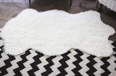 make your own faux sheepkin rug out of our Mongolian Faux Fur http://www.shannonfabrics.com/index.php?main_page=advanced_search_result&search_in_description=1&zenid=d9f7c8dc5848f7c253c406a12878b4d1&keyword=mongolian+faux+fur Tutorial at @Heidi Ferguson  http://www.honeybearlane.com/2013/04/make-a-faux-sheepskin-rug.html