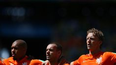 FORTALEZA, BRAZIL - JUNE 29: (L to R) Nigel de Jong, Wesley Sneijder and Dirk Kuyt of the Netherlands line up for the national anthem prior to the 2014 FIFA World Cup Brazil Round of 16 match between Netherlands and Mexico at Estadio Castelao on June 29, 2014 in Fortaleza, Brazil. (Photo by Alex Livesey - FIFA/FIFA via Getty Images)