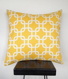 Bright, sunny yellow and white linked chain print cushion cover. DTLL