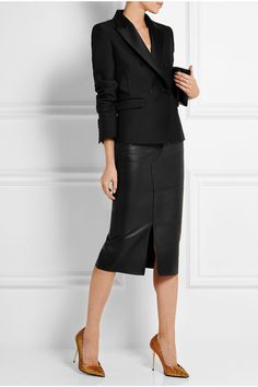 the edginess of the leather skirt and the classic lines of the jacket.