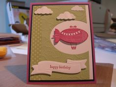 Stampin Up Spellbinders Memory Box  Stamps: Moving Forward  Paper: Certainly Celery, Marvelous Magenta  Ink: Marvelous Magenta  Accessories: SU Cloudy Day EF; Spellbinders Ribbon banners, ovals; Memory Box Puffy Clouds