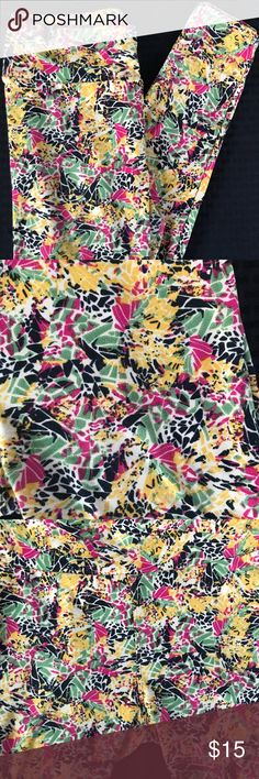 LuLaRoe Leggings OS One Size LuLaRoe OS One Size Women's leggings. Buttercream feel with yoga style waistband. Bright and funky design in black, sage green, yellow, cream and fuchsia. Fun design. In good condition. Very gently worn.  These look super cute with an oversized black tee or tunic. No snags, tears, or stains. Ready to go from my closet to yours. Item comes from a pet friendly, smoke free home. LuLaRoe Pants Leggings