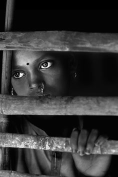 Encaged   Jayanta Roy (India) - no idea why this girl is locked up, but I doubt it's for a good reason