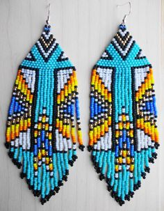 Size: The lenth of the earrings is approx. Aztec Earrings, Dangly Earrings, Seed Bead Earrings, Beaded Earrings, Seed Beads, Fringe Earrings, Bead Jewellery, Wire Jewelry, Beaded Jewelry